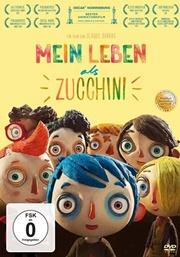 Der Junge Zucchini lächelt mit seinen Freunden in die Kamera.